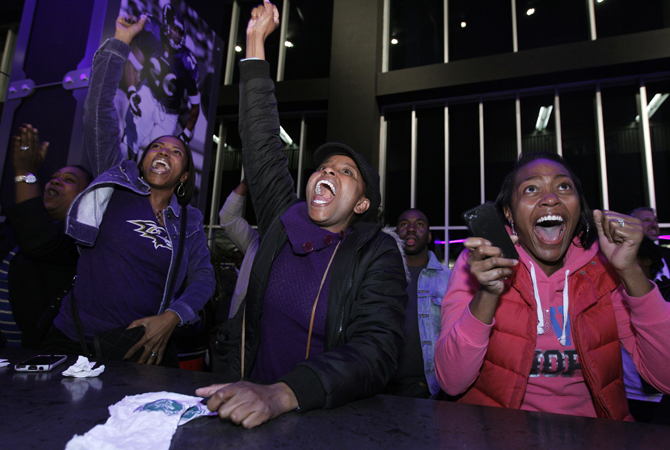 President Barack Obama supporters celebrate televised reports of his projected re-election for president of the United States during a rally at M&T Bank Stadium in Baltimore, Md., Tuesday, Nov. 6, 2012.—Photo by AFP