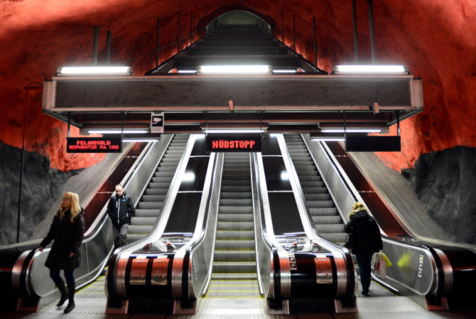 People use the escalator at the Solna subway station  in Stockholm.