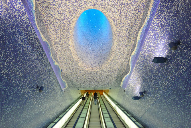 People walk in the ?Cathedral? with the Crater of Luz by artist Oscar Tusquet Blanca in the Toledo subway station as part of the ?Art Station Line 1? project in Naples.