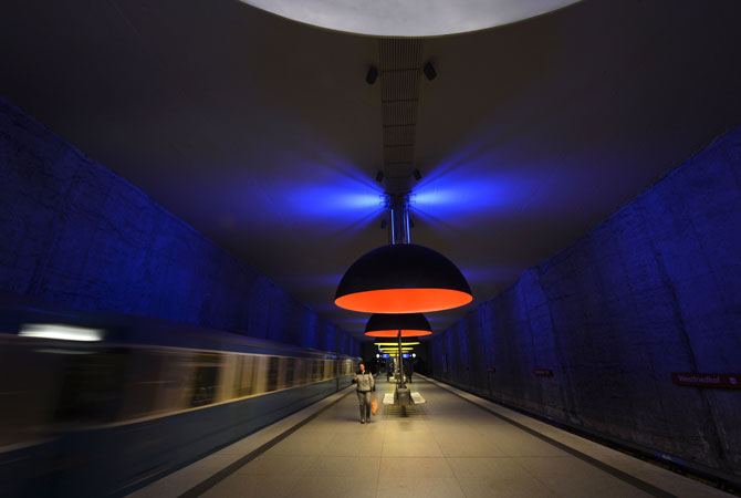 A train leaves the subway station Westfriedhof in Munich, southern Germany. The subway station was opened on May 23, 1998. Eleven large lamps measuring 3.80 metres in diameter were installed in 2001 and bathe the station in blue, red and yellow light.
