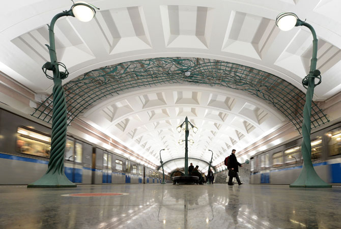 Subway passengers walk at the Slavyansky Bulvar metro station in Moscow.