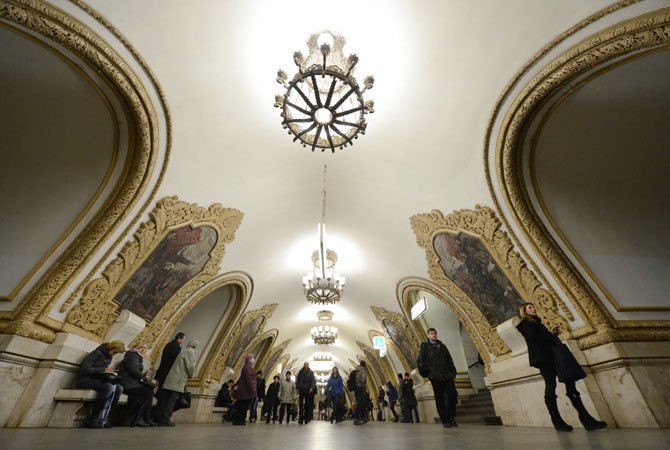 Subway passengers walk at the Kievskaya metro station of the Koltsevaya Line in Moscow.