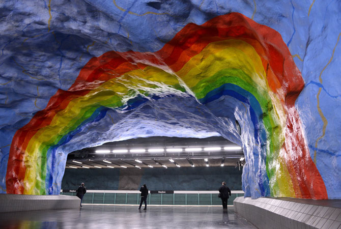People walk at the Stadion subway station in Stockholm.