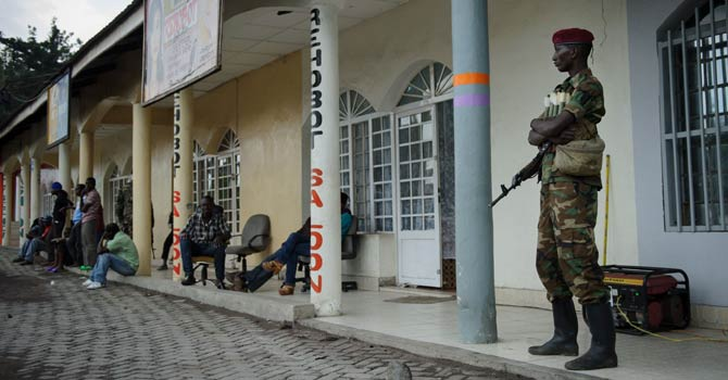 An M23 rebel soldier stands outside a shop in Goma, in the east of the Democratic Republic of Congo on Nov 28, 2012. The government accused rebels today of widespread looting in Goma as the fighters began pulling out of the strategic eastern city following diplomatic mediation to prevent the conflict spreading across the volatile region. - AFP Photo