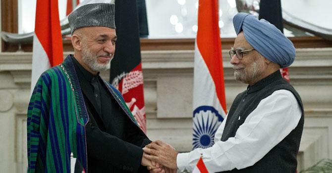Karzai-Singh-AFP-670