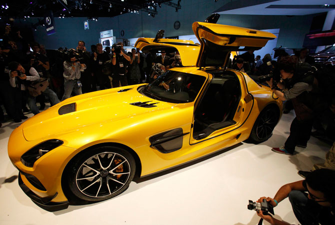 Photographers take pictures of the 2013 Mercedes-Benz SLS AMG gull wing at the 2012 Los Angeles Auto Show in Los Angeles, California November 28, 2012.