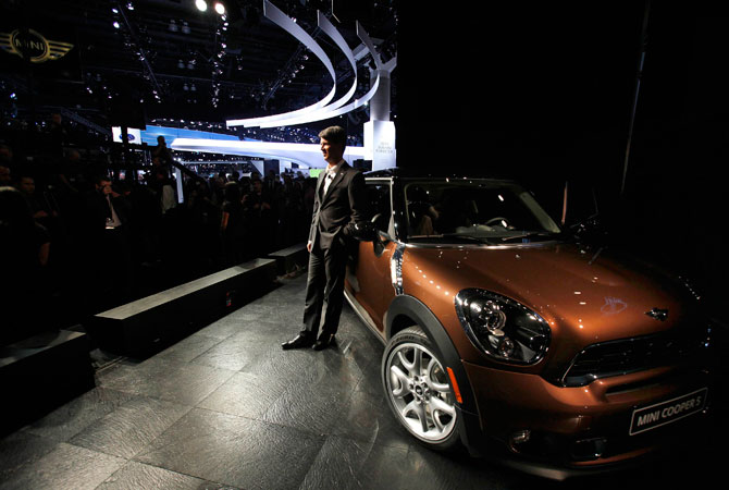 Harald Kruger, member of the board of management for the BMW Group, poses next to the 2013 Mini Paceman at the 2012 Los Angeles Auto Show in Los Angeles, California November 28, 2012.