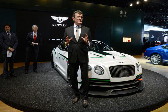 Kevin Rose, Bentley's Member of the Board for Sales, Marketing and Aftersales speaks at a news conference in front of a Bentley GT3 race concept car at the 2012 Los Angeles Auto Show in Los Angeles, California November 28, 2012.