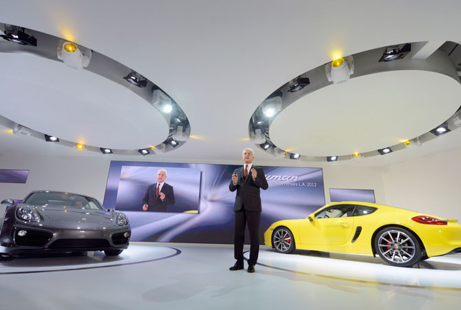 Matthias Muller, President and Chief Executive Officer of Porsche, speaks during a news conference unveiling the 2013 Porsche Cayman at the 2012 Los Angeles Auto Show in Los Angeles, California November 28, 2012.