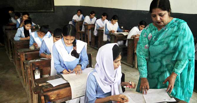 Students sit in an exam at a school in Pakistan. - File photo by Online