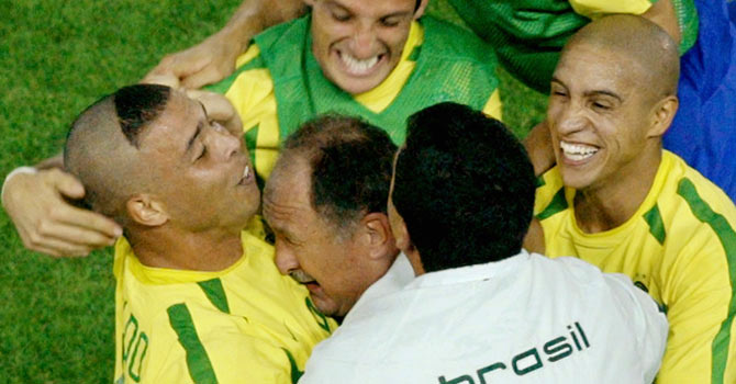 Brazil's Ronaldo (L) celebrates with coach Luiz Felipe Scolari (with head on Ronaldo's chest), team mates Belletti (top), Roberto Carlos (R) and an assistant coach after scoring his first goal against Germany in the second half of their World Cup final in Yokohama in this June 30, 2002 file photo. Scolari took over as the coach of 2014 World Cup hosts Brazil on November 29, 2012, returning for a second stint to lead his country's bid to win a sixth world title on home soil in little more than 18 months' time. The man known as Felipao (Big Phil), who led Brazil to their fifth and last World Cup win in 2002, was officially presented by the Brazilian Football Confederation (CBF) at a news conference, replacing Mano Menezes who was sacked last Friday. – File photo by Reuters