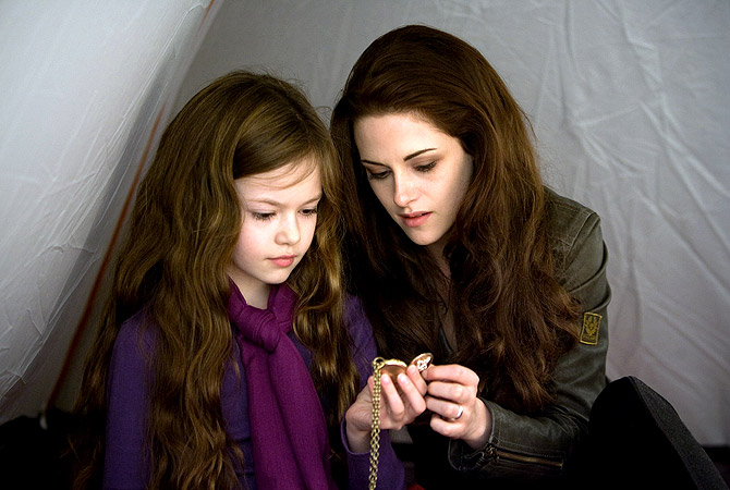 "This film image released by Summit Entertainment shows Mackenzie Foy, left, and Kristen Stewart in a scene from ""The Twilight Saga: Breaking Dawn Part 2."" ? AP Photo"