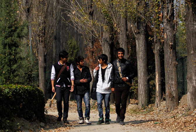 Band ?Sign - the signature of music? (R-L) guitarist Zahoor Qadir, 18, guitarist and lead singer Qassam Dar, 18, drummer Muneeb Khan, 17, and guitarist Azan Mullick, 18, arrive to perform on stage at a college in Srinagar.