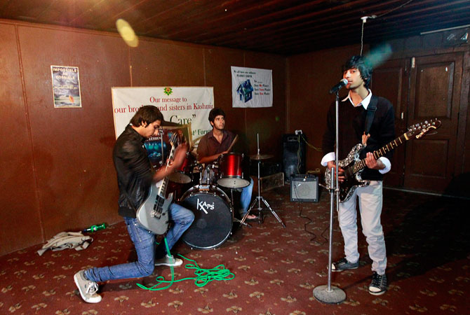 Members of the band ?Sign - the signature of music? (L-R) guitarist Zahoor Qadir, 18, drummer Muneeb Khan, 17, and guitarist and lead singer Qassam Dar, 18, take part in a jamming session in Srinagar October.