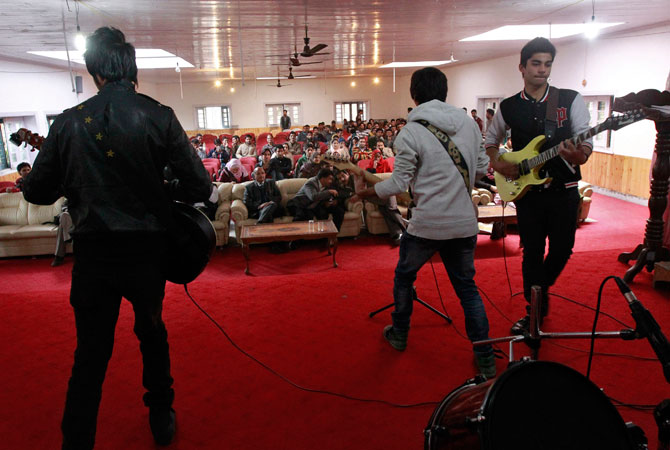 Band ?Sign - the signature of music? (L-R) guitarist Zahoor Qadir, 18, guitarist and lead singer Qassam Dar, 18, guitarist Azan Mullick, 18, and drummer Muneeb Khan, 17, (unseen) perform on stage at a college in Srinagar.