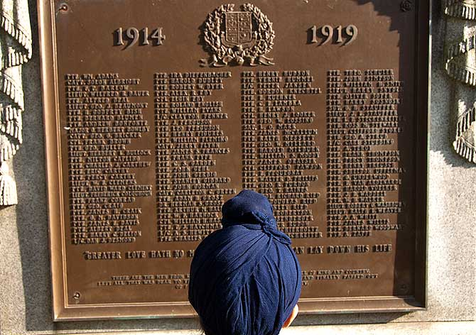 A Sikh boy looks at a memorial for Canadian soldiers for the First World War. – Photo courtesy author