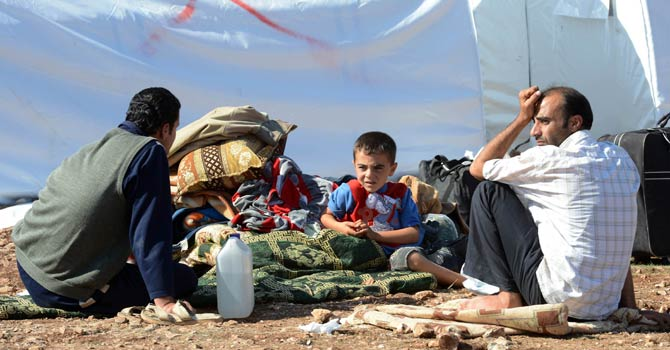 This file photo shows Syrian refugees at a refugee camp. - File Photo