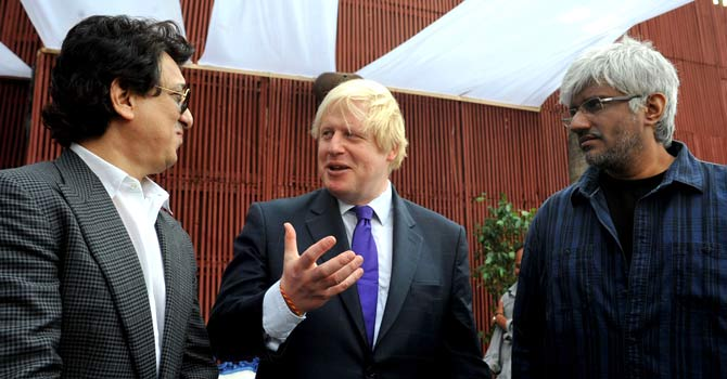 The Mayor of London Boris Johnson (C) speaks with Bollywood Vikram Bhatt (R) and Sajid Nadiadwala (L) during a meeting in Mumbai  – Photo by AFP