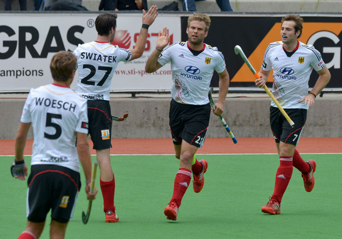 Captain Moritz Fuerste of Germany (C) is congratulated by team-mates after scoring the first goal during the first quarter final at the Men's Hockey Champions Trophy in Melbourne on December 6, 2012. Germany leads the match 1-0 at half-time. ? Photo by AFP