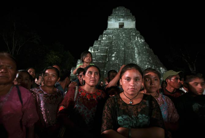 Aborigines ?Kekchi?, from Coban, gather as they protest a day before the Oxlajuj Baktun celebration at the Tikal Mayan ruins in Peten December 20, 2012. Indigenous activists protested outside Guatemala's ancient ruins of Tikal on Thursday as members of the country's poverty-stricken Mayan communities seek to draw international attention to their plight ahead of festivities to mark the end of the Mayan calendar. ? Photo by Reuters