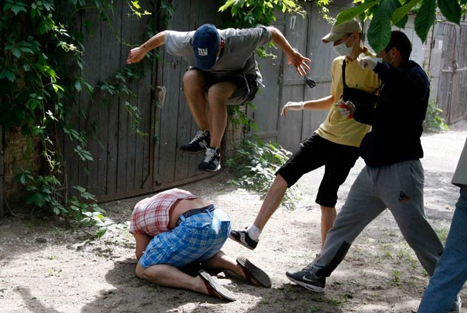 Unidentified people beat Svyatoslav Sheremet (L, bottom), head of Gay-Forum of Ukraine public organization, in Kiev, May 20, 2012. Sheremet was attacked after meeting with members of the media to inform them that a scheduled gay parade was cancelled. The attackers ran off when they realized members of the media were documenting the attack.