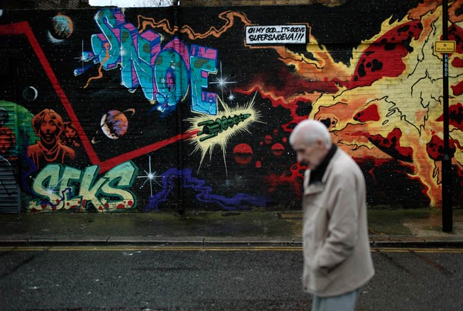 A man walks past street art in east London, Thursday, Dec. 20, 2012. The clock is ticking down to Dec. 21, the supposed end of the Mayan calendar, and from China to California to Mexico, thousands are getting ready for what they think is going to be a fateful day.? Photo by AP