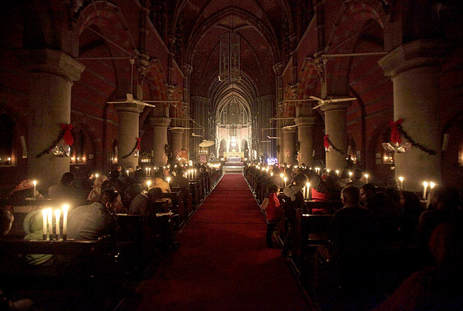 LAHORE: Christian community participating in candle light service to mark the Christmas celebrations at Cathedral Church. ? INP Photo
