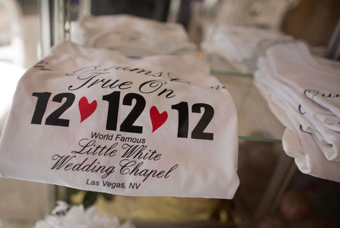 Tee shirts advertising the 12-12-12 date sit on display at A Little White Wedding Chapel, Tuesday, Dec. 11, 2012, in Las Vegas. These ?once-in-a-century? wedding dates have become more important each year as people increasingly look outside Vegas for nontraditional weddings. Once known as the wedding capital of the world, Vegas' share of the US wedding market has fallen by a third since 2004.