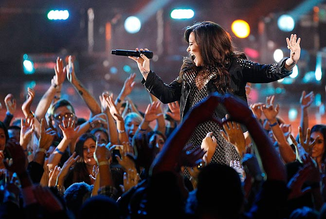 "Recording artist Demi Lovato performs ""Give Your Heart a Break"" during the VH1 Divas 2012 show in Los Angeles, December 16, 2012. ? Reuters Photo"
