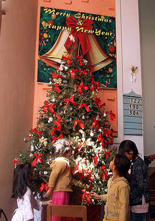 HYDERABAD: Christian girls decorating the Charismas tree at St Philip's Church in connection with Christmas celebrations. ? INP Photo