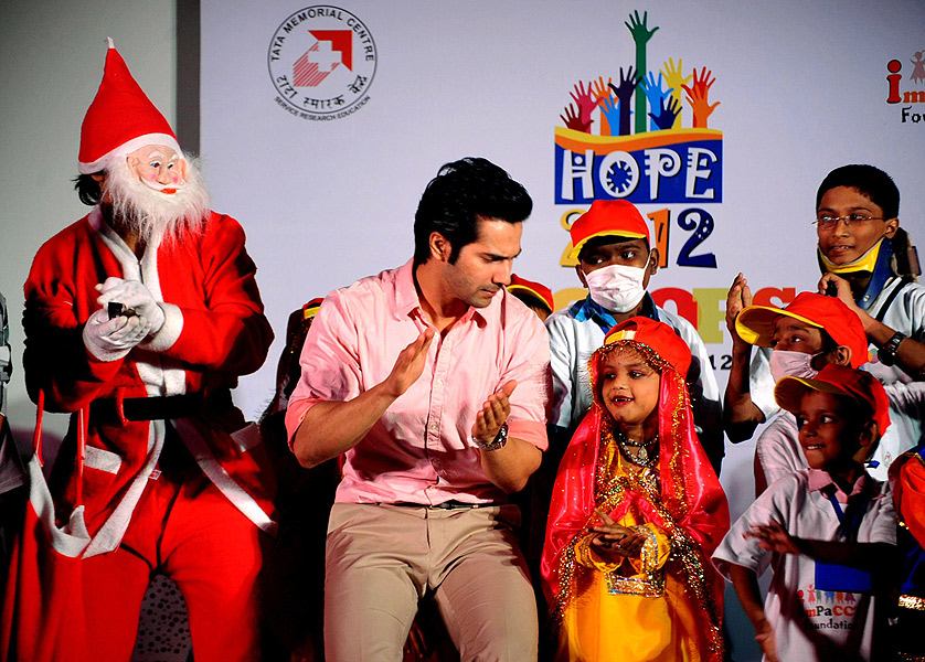 indian bollywood actor varun dhawan c takes part in a christmas performance for cancer