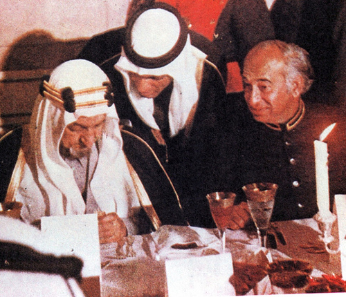 Z A. Bhutto (right) with Saudi king, Shah Faisal at a banquet in Karachi.