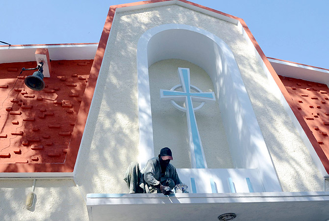 HYDERABAD: Worker is busy in painting the St Philip's Church for upcoming Christmas celebrations. ? INP Photo