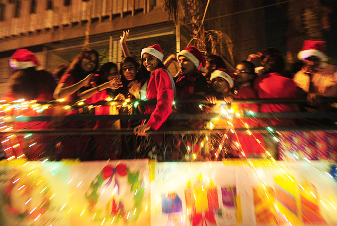 Pakistani Christians celebrate Christmas on a truck in Karachi on December 22, 2012. There is a tiny Christian minority in Pakistan, where only three per cent of the population of 167 million are estimated to be non-Muslim.  ? AFP Photo