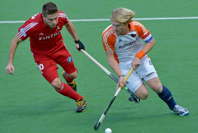 Captain Klaas Vermeulen of The Netherlands (Right) beats Cedric Charlier of Belgium (Left) to the ball during their Pool B match at the Men's Hockey Champions Trophy tournament in Melbourne on December 4, 2012. The Netherlands won the match 5-4.