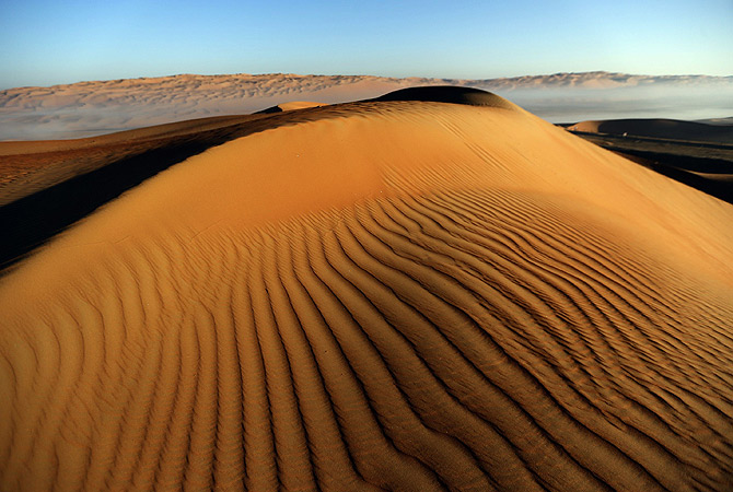 A general view shows striations of a dune in the Liwa desert, 220 kms west of Abu Dhabi, on the sidelines of the Mazayin Dhafra Camel Festival. ? AFP Photo