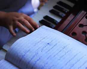Fareedon 's expert fingers seem to flow over the keyboard. -Photo by Nadir Siddqui/Dawn.com