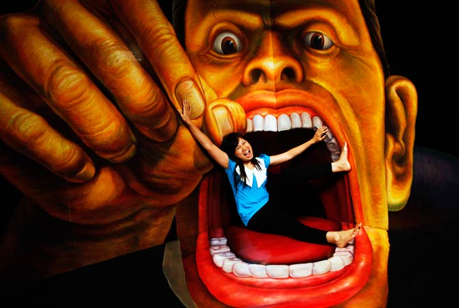 A girl poses with a 3-D artwork at the Trick Museum.