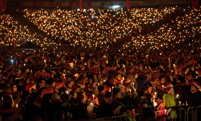 Supporters of the German second division football club FC Union Berlin attend the 10th Christmas singing at Stadium Alte Foersterei in Berlin, on December 23, 2012. For two hours, more than 20000 people sang Christmas songs. ? Photo by AFP