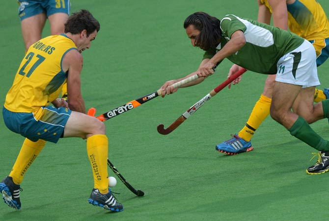 Shakeel Abbasi of Pakistan (Right) fights for the ball with Kieren Govers of Australia (Left) during their Pool B match at the Men's Hockey Champions Trophy tournament in Melbourne on December 4, 2012. Australia won the match 1-0 at full-time.