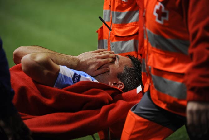Malaga's French midfielder Jeremy Toulalan lies on a stretcher after being injured during the UEFA Champions League Group C football match Malaga CF vs RSC Anderlecht at La Rosaleda stadium in Malaga.
