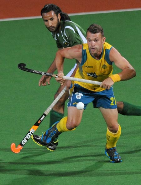 Glen Simpson of Australia (Right) beat Shakeel Abbasi of Pakistan to the ball during their Pool B match at the Men's Hockey Champions Trophy tournament in Melbourne on December 4, 2012.  Australia won the match 1-0 at full-time.