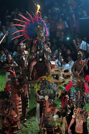Members of a folkloric group perform during celebrations marking the end of the Mayan age, December 20, 2012 at the Tikal archaeological site, Peten departament, 560 kms north of Guatemala City. Ceremonies are being held to celebrate the end of the Mayan cycle known as Bak'tun 13 and the start of the new Maya Era on December 21. ? Photo by AFP