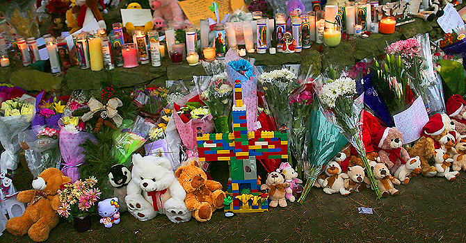 Teddy bears, flowers and candles in memory of those killed, are left at a memorial down the street from the Sandy Hook School in Newtown, Connecticut.—Photo by AFP/File