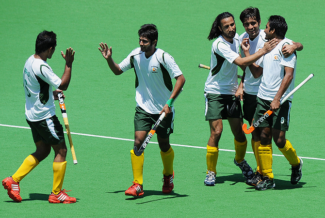 Pakistan celebrate scoring their second goal.