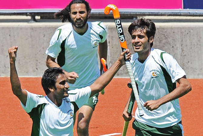 Shafqat Rasool of Pakistan (L) gestures after scoring the second goal against Belgium.