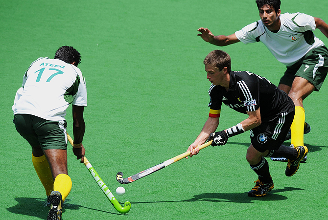 Captain Jerome Truyens of Belgium (R) fights Muhammad Ateeq of Pakistan (L).