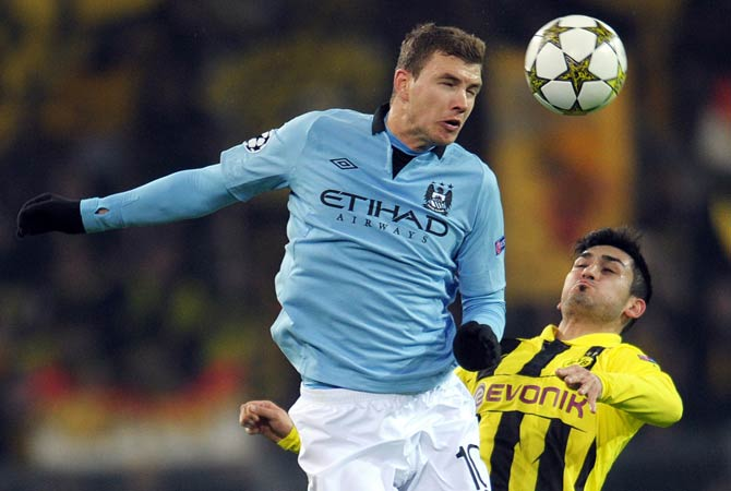 Edin Dzeko of Manchester (Left) and Dortmund's Ilkay Guendogan (Right) vie for the ball during the UEFA Champions League Group D football match Borrusia Dortmund vs Manchester City in Dortmund, western Germany.