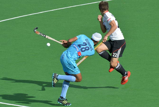 Marco Miltkau of Germany (Right) leaps as Gurmail Singh of India (Left) has a crack at goal during the German - India Pool A match at the Men's Hockey Champions Trophy tournament in Melbourne on December 4, 2012. Germany won the match 3-2.   8- Klaas Vermeulen of the Netherlands hits the ball during the Pool B match against Belgium at the Men's Hockey Champions Trophy tournament in Melbourne on December 4, 2012. The Nehterlands was leading 3-0 at half-time.