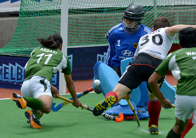 Felix Reuss of Germany  deflects a ball from Shakeel Abbasi of Pakisan during the first quarter final at the Men's Hockey Champions Trophy in Melbourne on December 6, 2012. Pakistan beat the number one ranked Germany 2-1. ? Photo by AFP